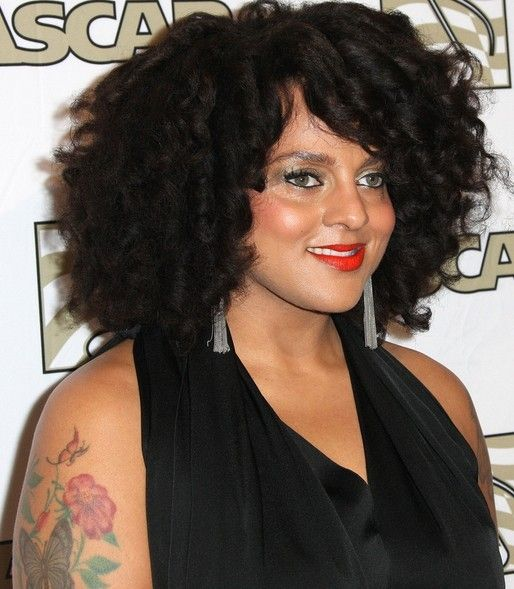 Marsha Ambrosius` Tattoos - Flower Tattoo on Upper Arm