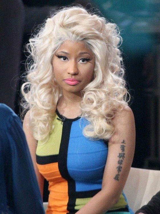 Nicki Minaj`s Tattoos - Lettering Tattoo on Upper Arm