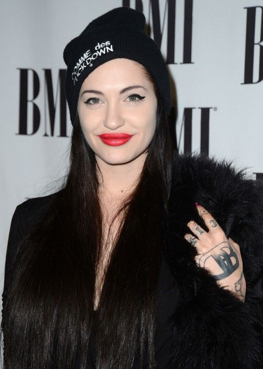 Porcelain Black`s Tattoos - Lettering Tattoo on Back of Hand
